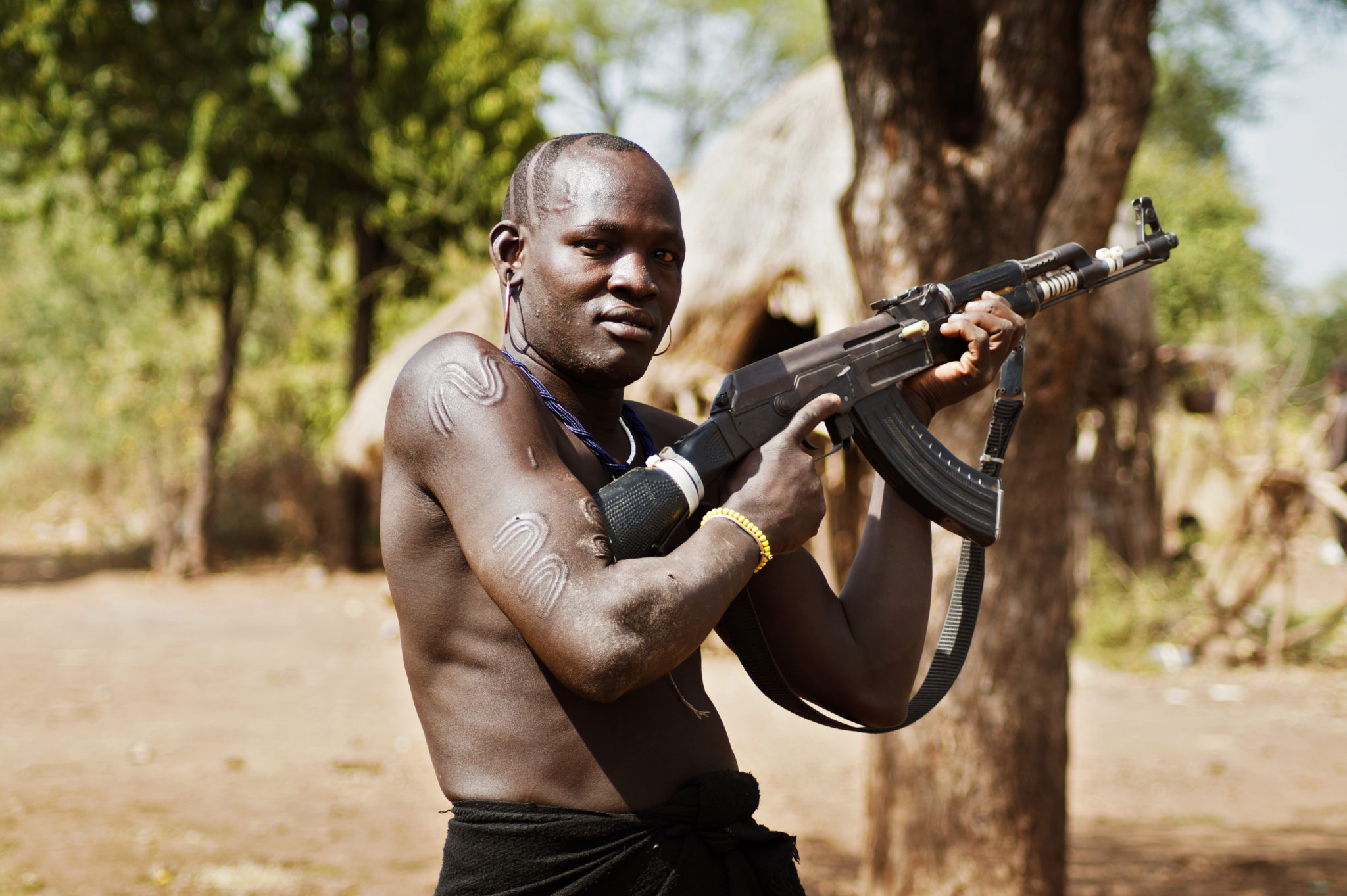 Mursi-people-Ethiopia-warrior-kalashnikov