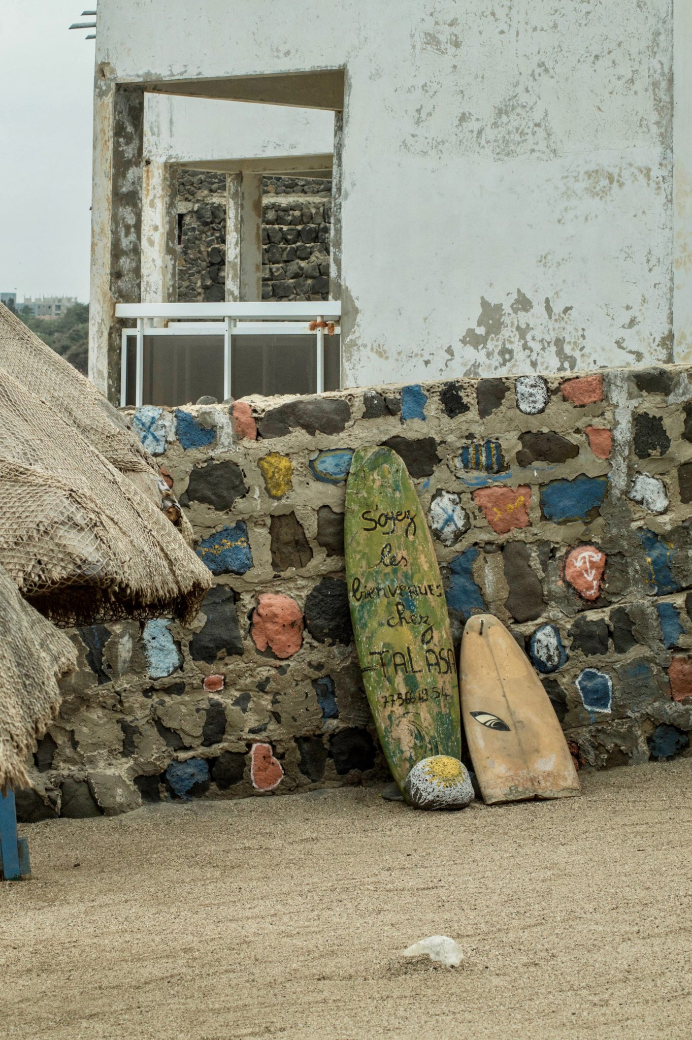 Senegal surf: Broken boards as decoration on Ngor Island