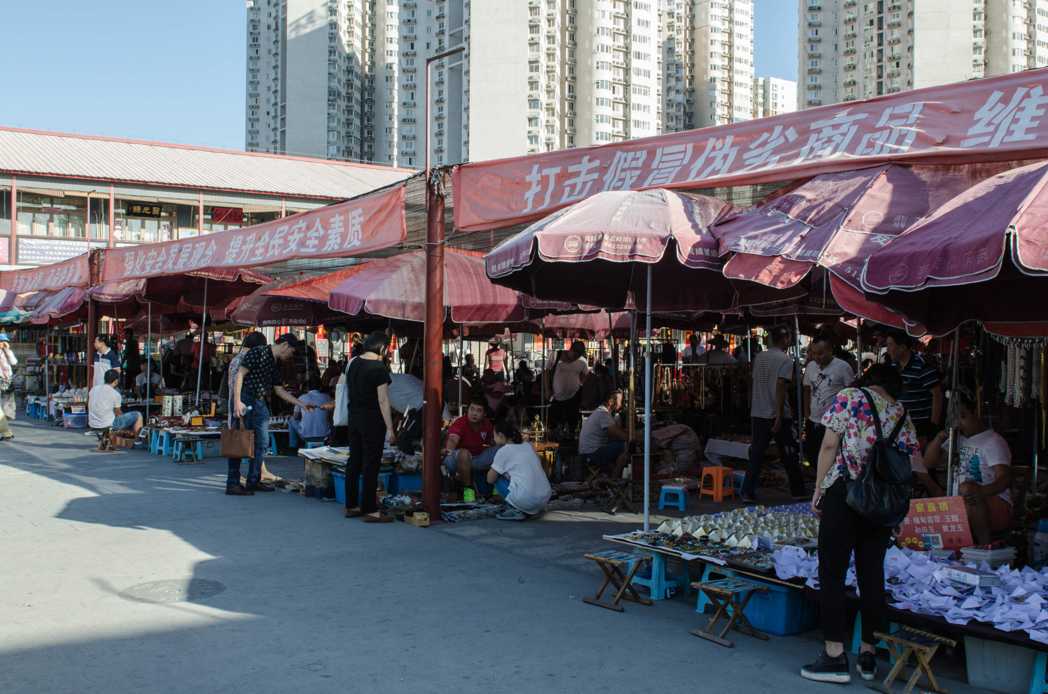 The Panjiayuan Antique Market in Beijing: The stalls are covered during the midday heat