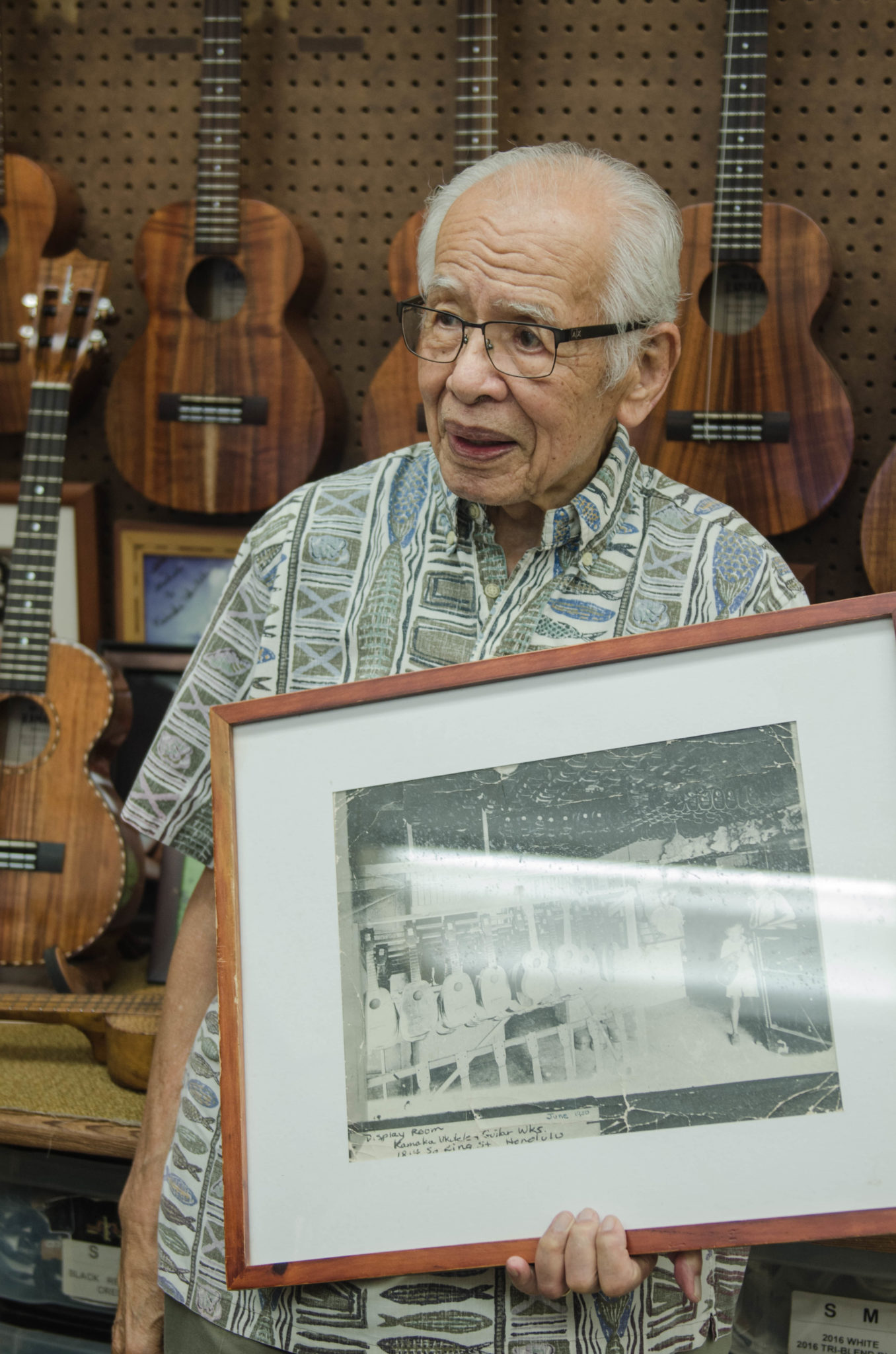 At the Hawaii guitar shop Kamaka Ukulele Hawaii small guitars are not only being sold, but stories are told by the very own Fred Kamaka.