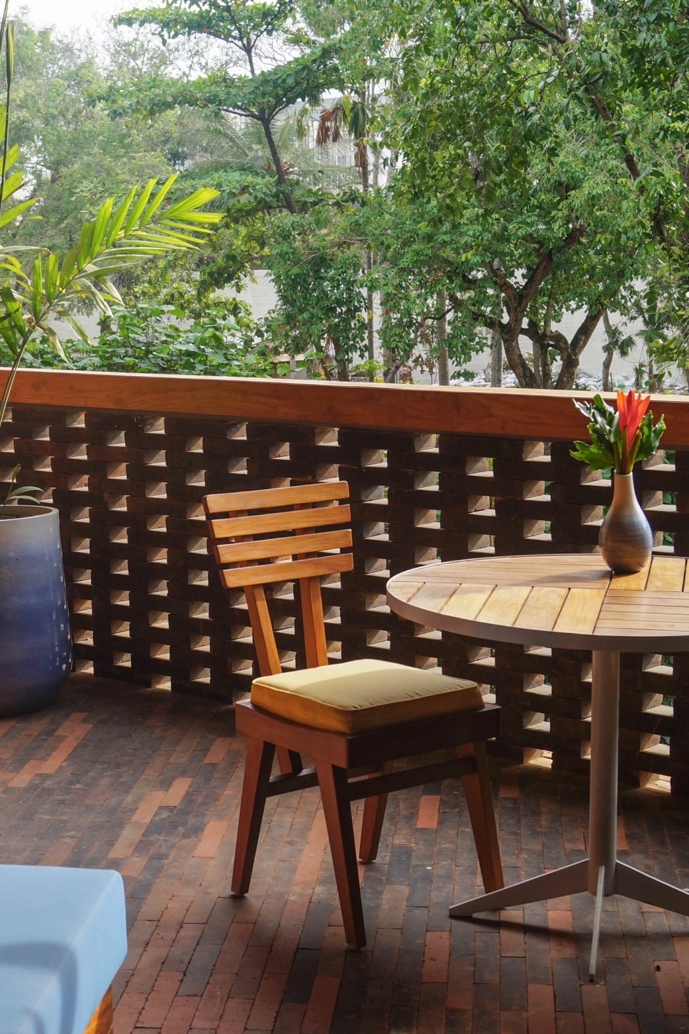 Katamama Hotel Bali: The terrace is furnished with a couch and a table.